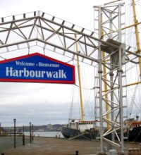 The Harbourwalk at Pier 21, with a tall ship docked in the port