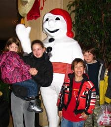 Kids with Bonhomme at Quebec Carnival