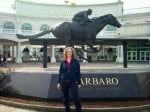 Linda Aksomitis at Churchill Downs in Louisville, Kentucky, in front of the Barbaro statue.