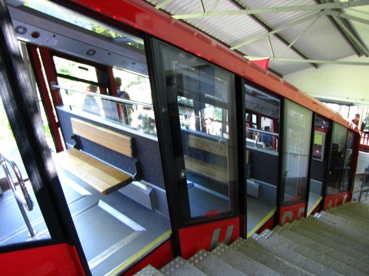 The Harderbahn Funicular parked at the station with a close-up of the three loading compartments.
