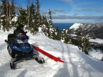 Snowmobile trip through the mountains in La Haute Gaspesie region of Quebec.