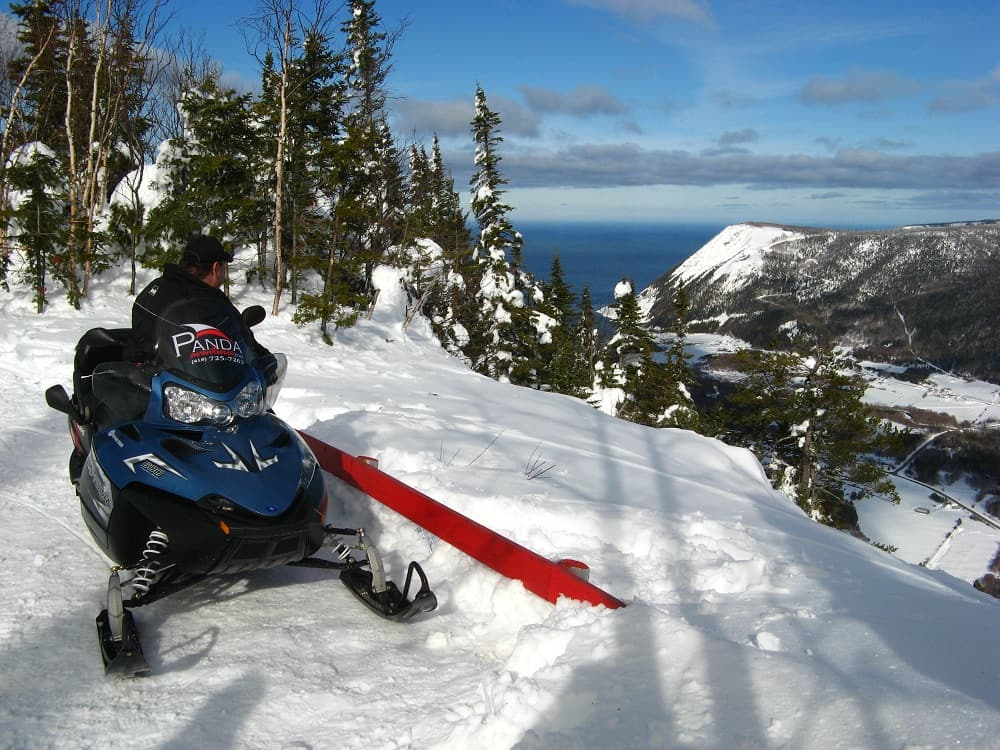 Snowmobile trip through the mountains in La Haute Gaspesie region of Quebec.