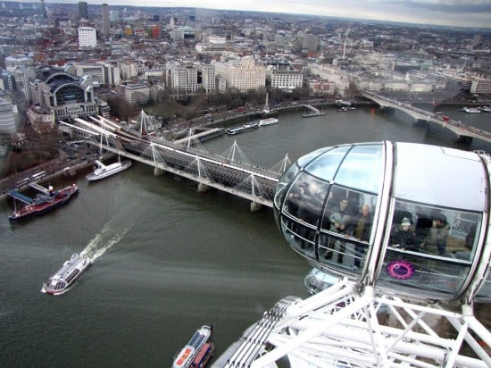 Our car reaches max height on the London Eye and we can see the city and other cars below us.