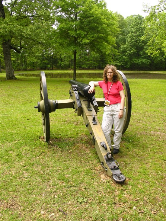 Linda Aksomitis in front of a canon at Shiloh Battlefield