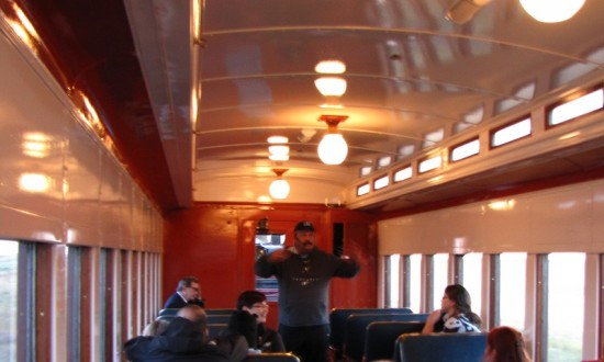 Interior of the Pullman train car on the Southern Prairie Railroad with astronomer, Mike Klancy, talking on the inaugural Star Gazing Tour.