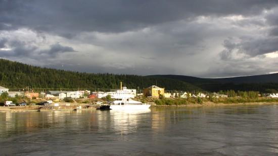 Dawson City under stormy skies as viewed from the Klondike Spirit paddlewheeler.