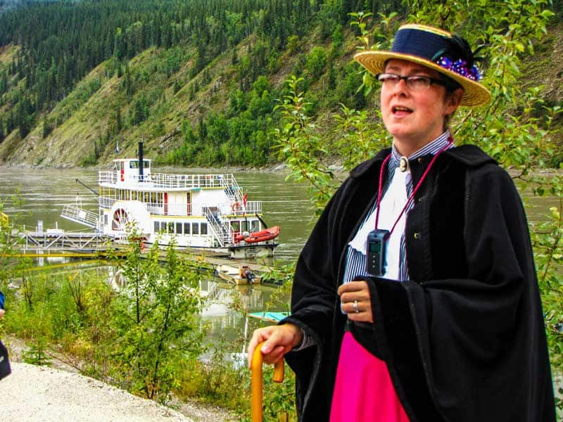Tour guide talking about the arrival of minors during the gold rush - Klondike Spirit Paddlewheeler in the background.