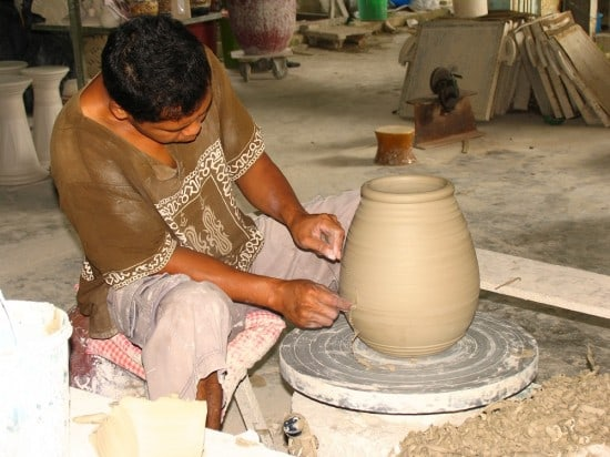 Artisan working on pottery at the Pottery Factory in Kuching.