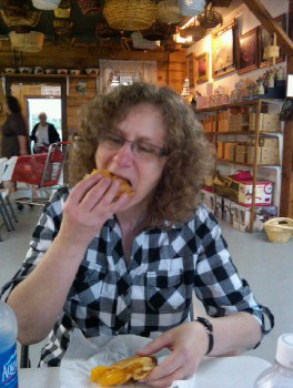 Linda Aksomitis eating fried peach pie.