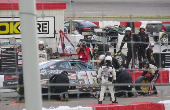 Stock car #56 doing a tire change during the NASCAR event in Saskatoon.