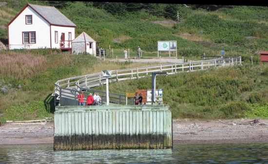Landing dock and historic buildings on Bonaventure Island in Quebec.