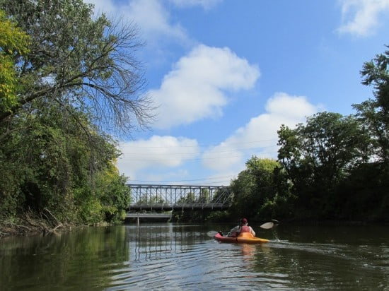 Kayaking under the historic truss bridge over the St. Mary River in Fort Wayne, Indiana.
