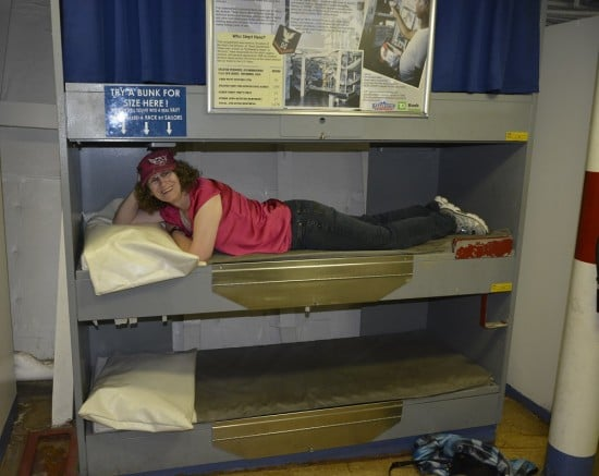 Linda Aksomitis in a bunk on the USS New Jersey battleship.