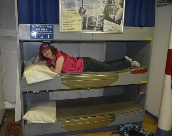 Linda Aksomitis in a bunk on the USS New Jersey battleship.