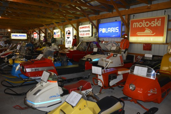 Vintage snowmobiles and signs