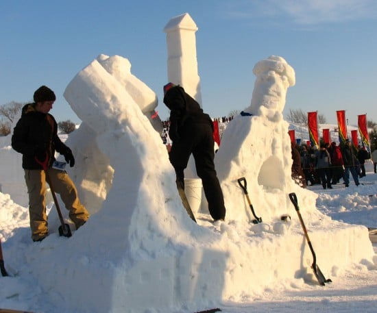 Sculptors working on a snow sculpture at Quebec Winter Carnival. 2006.
