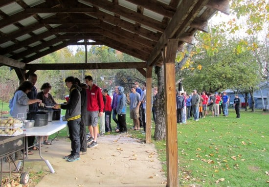 Rafters lined up for the pig roast after whitewater rafting.