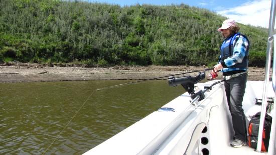 Linda Aksomitis fishing with Lake Diefenbaker Charters.