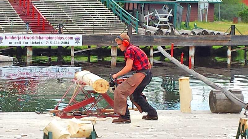 Speed contest between a modern chainsaw and the traditional bucksaw at the Lumberjack Show.