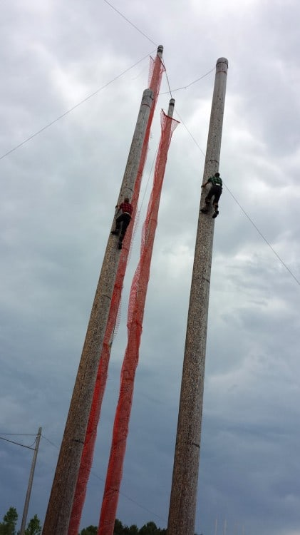 Climbing the poles at Fred Scheer's Lumberjack Show.
