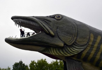 People in the jaws of the giant musky