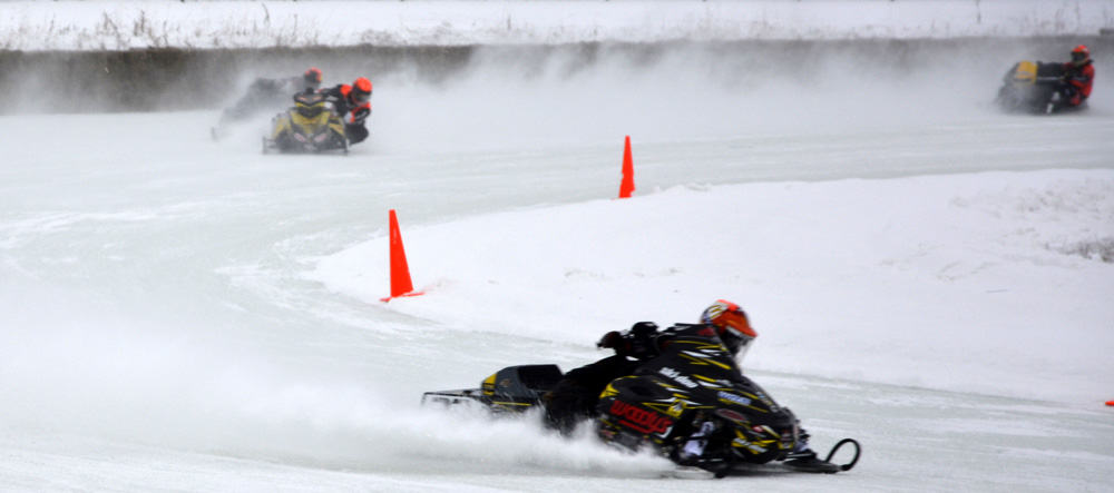 100+ Miles Per Hour Just Inches Off the Ice–Oval Snowmobile Racing!