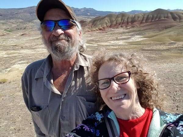 David Aksomitis & Linda Aksomitis with the Painted Hills behind them.
