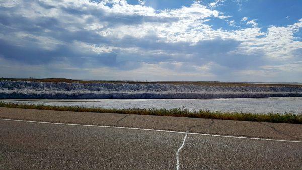 White salt against the Trans-Canada Highway at Chaplin, Saskatchewan.