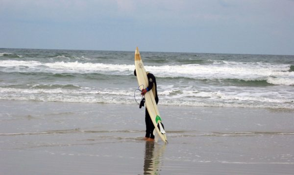 "Surfer on Ponce Inlet in Florida, known locally as ""the wave magnet."""