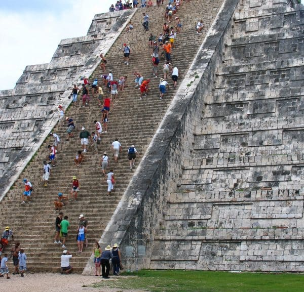 Climbing the steps of Chichen Itza