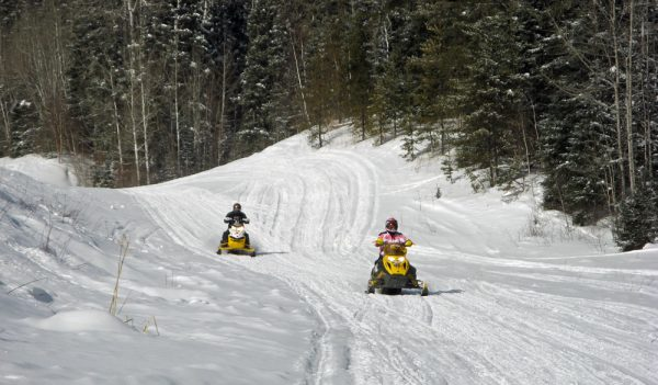 Snowmobiling near Waskesiu.