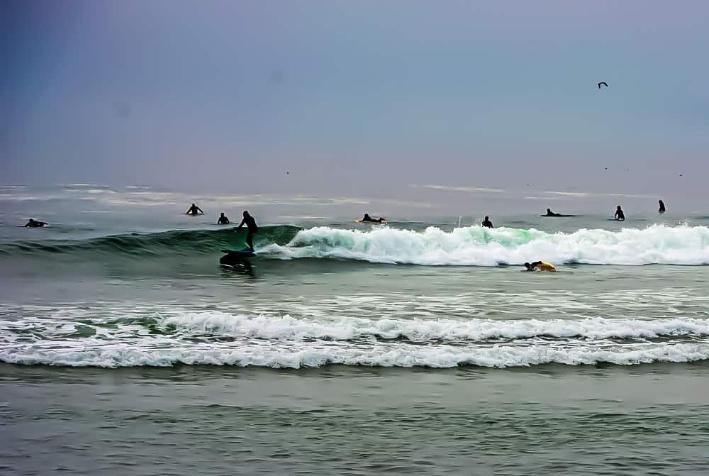 Surfers at Morro Beach, California.