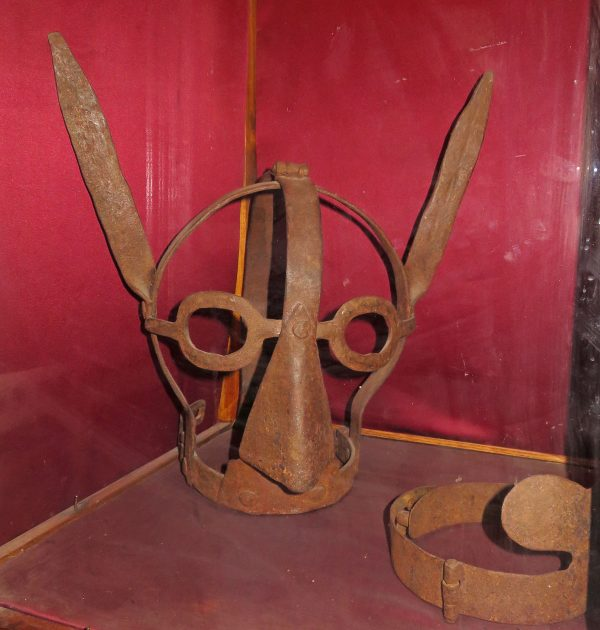 Mask at the Amsterdam Torture Museum.