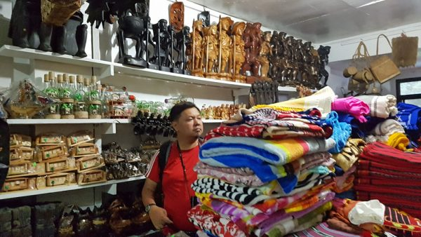 Locally woven blankets and other handmade crafts inside the Cherish Arts store.