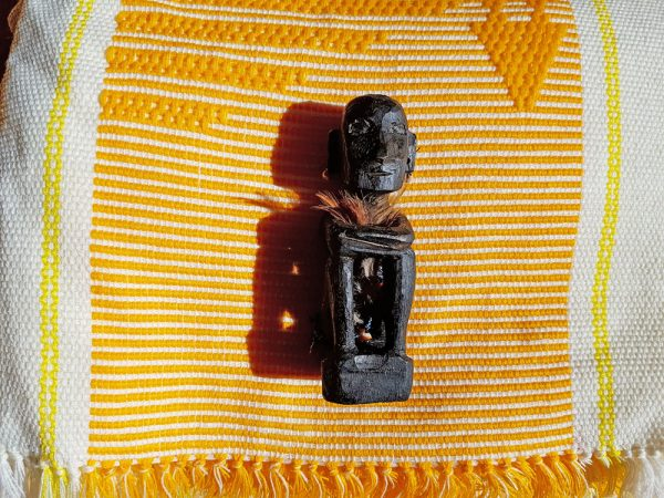 Ifugao hand woven blanket and hand carved bulol figure.