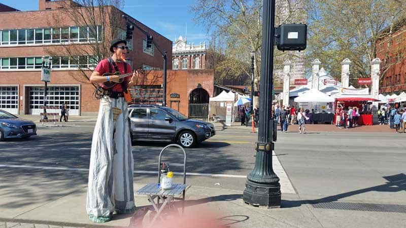 Entertainer on stilts at the Portland Saturday Market.