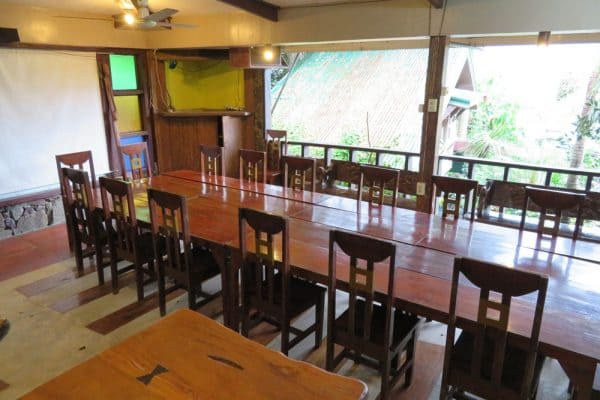 Hand carved table and chairs at Ibulao, Ibulao Bed & Breakfast Restaurant in Banaue, Philippines.