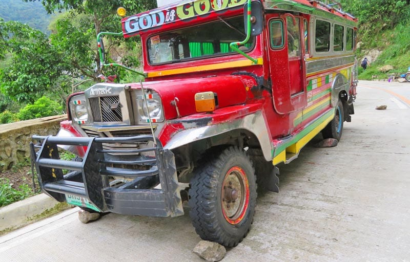 Jeepney parked on the highway.