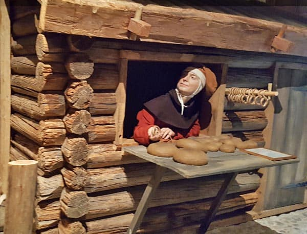 Woman selling bread at the Medieval Museum in Stockholm.