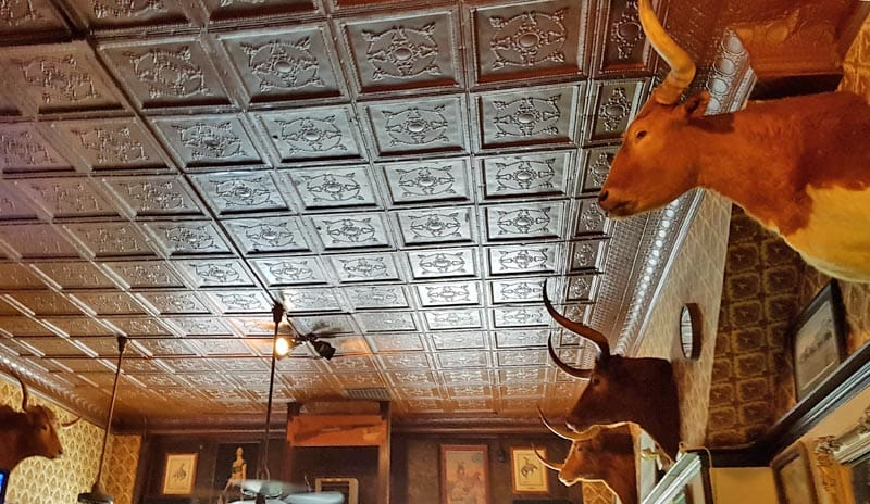 Look up at the Montana Bar in Miles City to see the vintage ceiling and longhorn mounts.