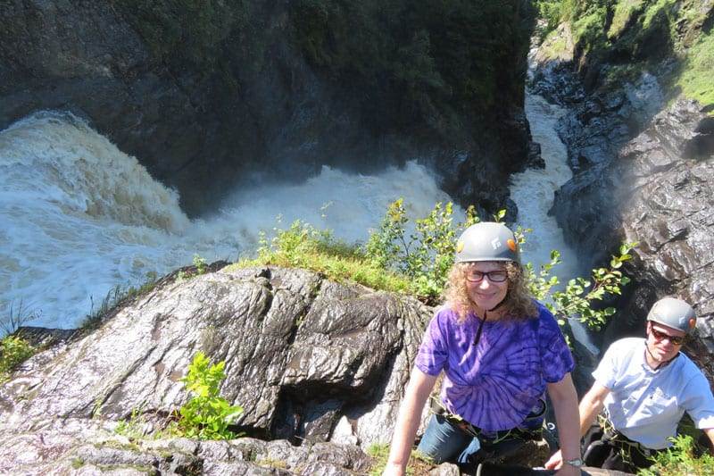 Linda Aksomitis climbing the last rocks at Canyon Sainte-Anne on the via ferrata