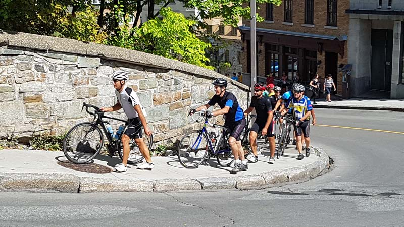 Amateur cyclists biking parts of the same course as the professionals on the Grand Prix Cycliste de Québec.