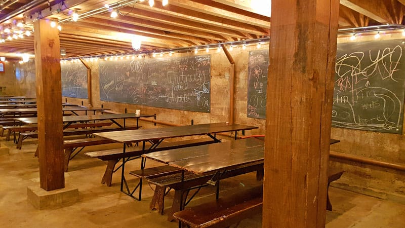 Tables in the historic tasting room at Tin Mill Brewery.