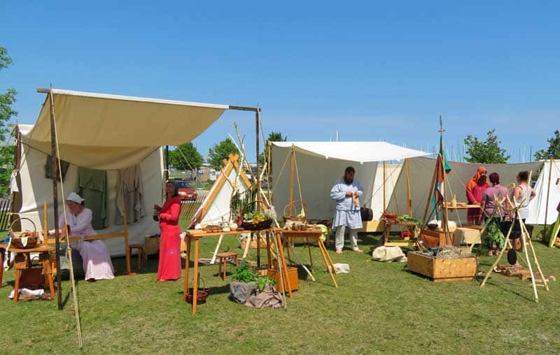 Viking village with tents and traditional activities at Gimli's Icelandic Festival of Manitoba.