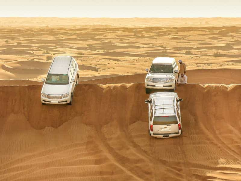 All terrain vehicles crossing the desert.