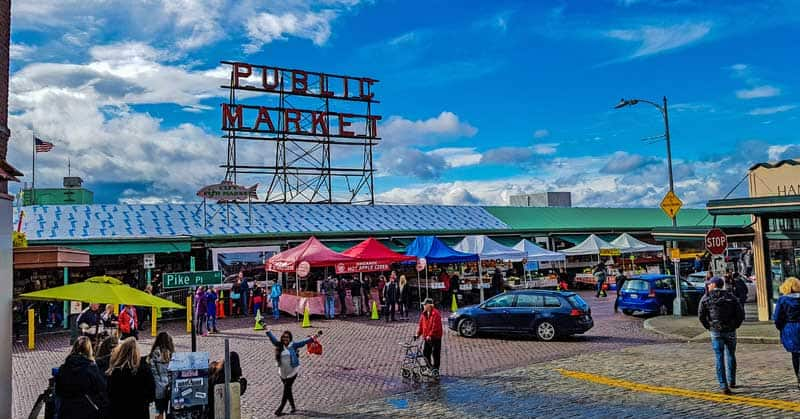 Visit the public market at historic Pike Place in Seattle.