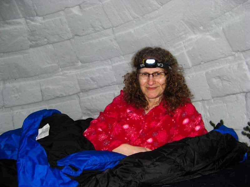 Linda Aksomitis sleeping in an igloo in Quebec.