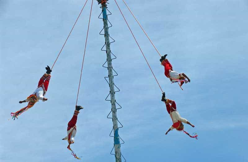 See Danza de los Voladores, or the Dance of the Flyers, on one of your day trips from Cancun in Mexico.