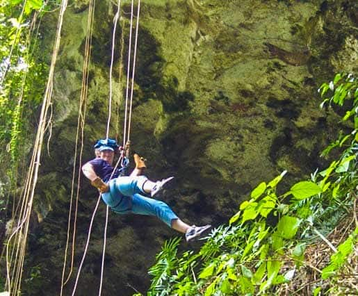 Linda Aksomitis rappelling in Mexico on a Mayan adventure.