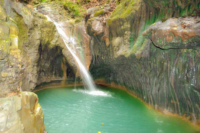 One of the falls you can slide down or jump from on the Damajagua Falls tour.